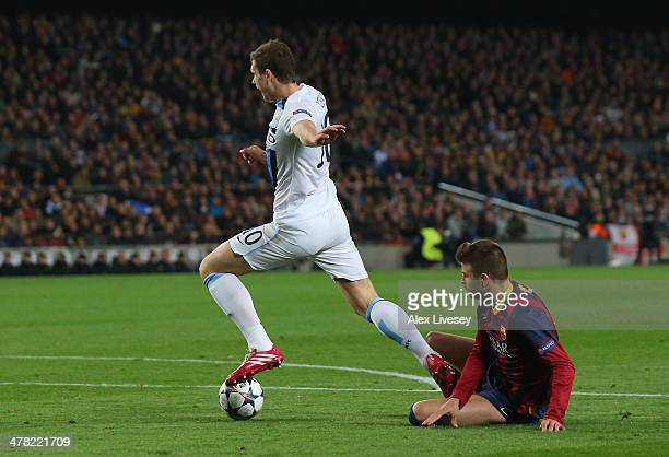 Edin Dzeko of Manchester City is fouled in the penalty area by Gerard Pique of FC Barcelona but a penalty appeal is turned down during the UEFA...