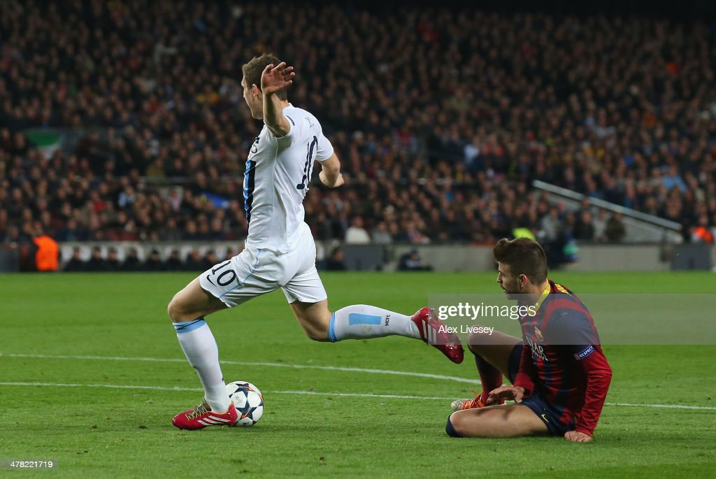 Edin Dzeko of Manchester City is fouled in the penalty area by Gerard Pique of FC Barcelona but a penalty appeal is turned down during the UEFA Champions League Round of 16 match between FC Barcelona and Manchester City at Camp Nou on March 12, 2014 in Barcelona, Spain.