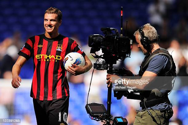 Edin Dzeko of Manchester City leaves the pitch with the matchball after scoring four goals after the Barclays Premier League match between Tottenham...