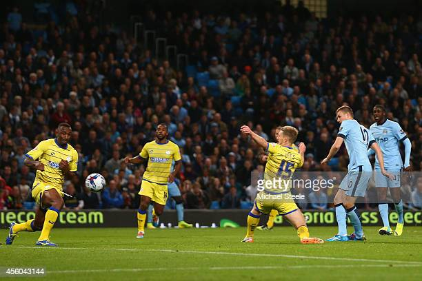 Edin Dzeko of Manchester City scores his sides second goal during the Capital One Cup Third Round match between Manchester City and Sheffield...