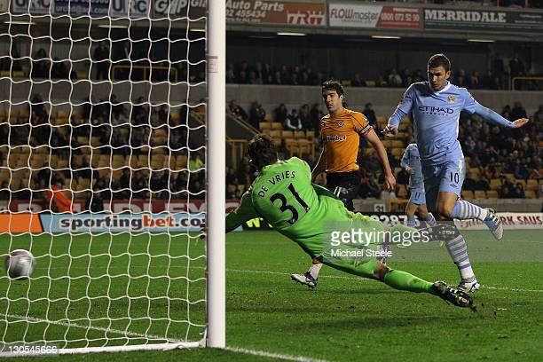 Edin Dzeko of Manchester City scores his teams fifth goal during the Carling Cup Fourth Round match at Molineux on October 26 2011 in Wolverhampton...