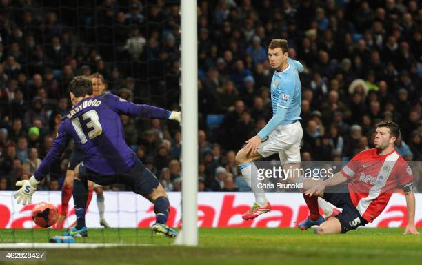 Edin Dzeko of Manchester City scores his team's fifth goal during the Budweiser FA Cup Third Round Replay match between Manchester City and Blackburn...