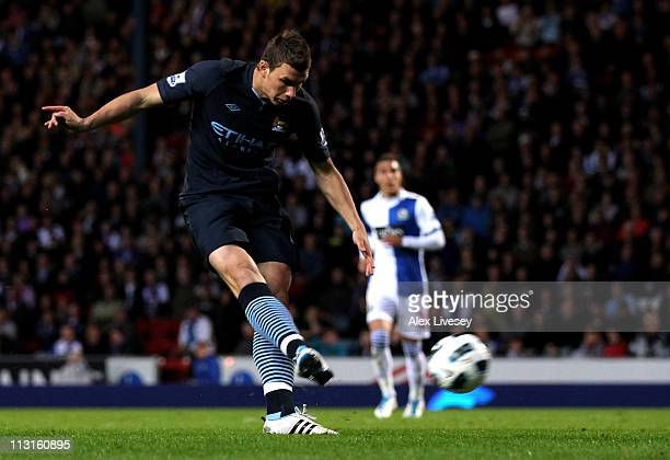 Edin Dzeko of Manchester City scores the opening goal during the Barclays Premier League match between Blackburn Rovers and Manchester City at Ewood...