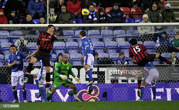 Edin Dzeko of Manchester City scores the opening goal during the Barclays Premier League match between Wigan Athletic and Manchester City at the DW...