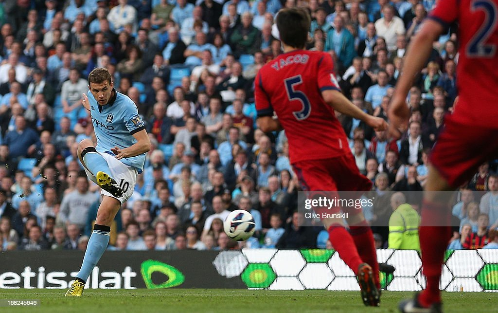Edin Dzeko of Manchester City scores the opening goal during the Barclays Premier League match between Manchester City and West Bromwich Albion at the Etihad Stadium on May 07, 2013 in Manchester, England.