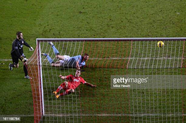 Edin Dzeko of Manchester City scores their first goal during the Barclays Premier League match between Southampton and Manchester City at St Mary's...