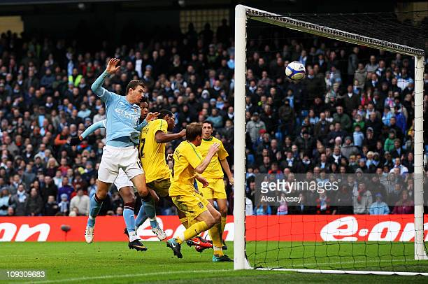 Edin Dzeko of Manchester City scores their fourth goal during the FA Cup sponsored by EOn 4th Round replay match between Manchester City and Notts...
