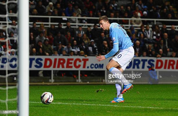 Edin Dzeko of Manchester City scores their second goal during the Capital One Cup Fourth Round match between Newcastle United and Manchester City at...