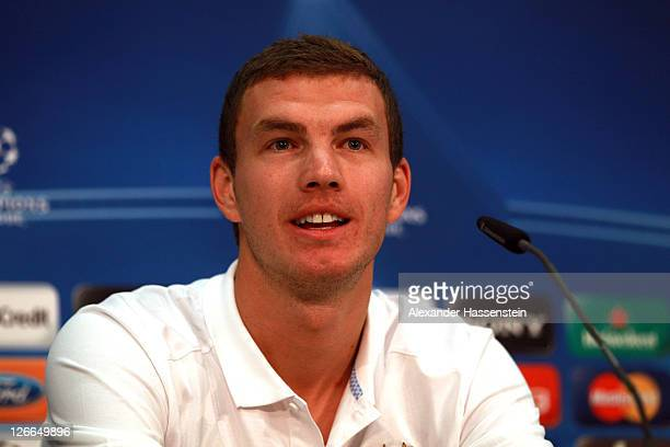 Edin Dzeko of Manchester City talks to the media during a press conference ahead of the UEFA Champions League group A first leg match against Bayern...