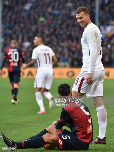 Edin Dzeko of Roma and Armando Izzo of Genoa during the Serie A match between Genoa CFC and AS Roma at Stadio Luigi Ferraris on November 26 2017 in...