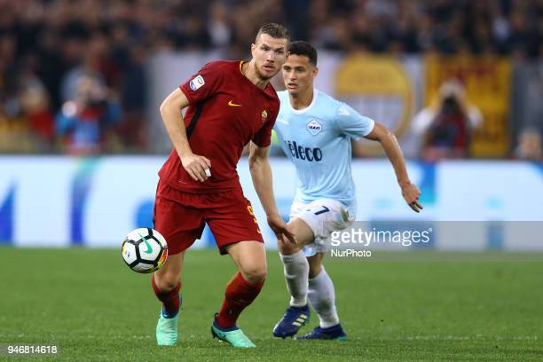 Edin Dzeko of Roma and Luiz Felipe of Lazio during the serie A match between SS Lazio and AS Roma at Stadio Olimpico on April 15 2018 in Rome Italy
