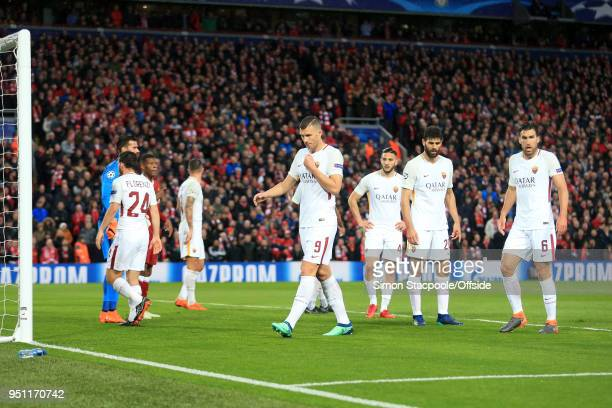 Edin Dzeko of Roma and teammates look dejected during the UEFA Champions League Semi Final First Leg match between Liverpool and AS Roma at Anfield...