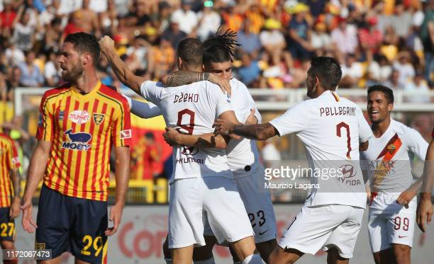 Edin Dzeko of Roma celebrates after scoring his team's opening goal during the Serie A match between US Lecce and AS Roma at Stadio Via del Mare on...