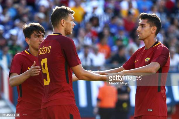 Edin Dzeko of Roma celebrates with Lorenzo Pellegrini after scoring a goal against Juventus during the International Champions Cup 2017 match at...