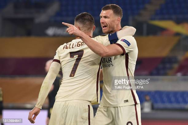 Edin Dzeko of Roma celebrates with teammate Lorenzo Pellegrini after scoring their team's first goal during the UEFA Europa League Quarter Final...
