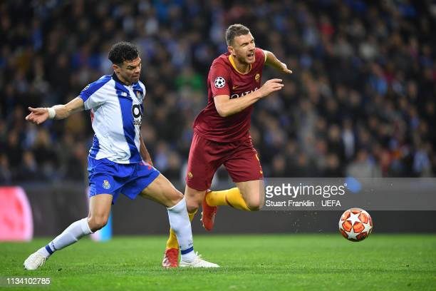 Edin Dzeko of Roma is challenged by Pepe of Porto during the UEFA Champions League Round of 16 Second Leg match between FC Porto and AS Roma at...