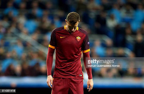 Edin Dzeko of Roma reacts during the UEFA Champions League Round of 16 Second Leg match between Real Madrid CF and AS Roma at Estadio Santiago...