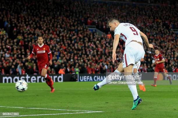 Edin Dzeko of Roma scores their 1st goal during the UEFA Champions League Semi Final First Leg match between Liverpool and AS Roma at Anfield on...