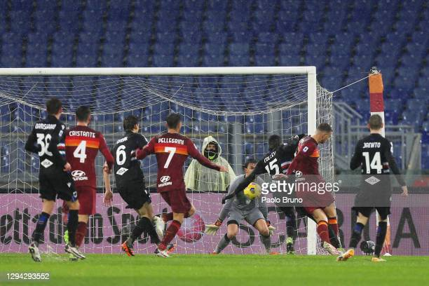Edin Dzeko of Roma scores their sides first goal during the Serie A match between AS Roma and UC Sampdoria at Stadio Olimpico on January 03, 2021 in...