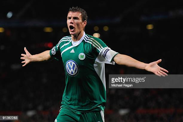 Edin Dzeko of VfL Wolfsburg celebrates scoring the opening goal during the UEFA Champions League Group B match between Manchester United and VfL...