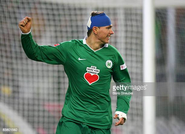 Edin Dzeko of VfL Wolfsburg celebrates the fifth goal during the Bundesliga match between VfL Wolfsburg and VfB Stuttgart at the Volkswagen Arena on...