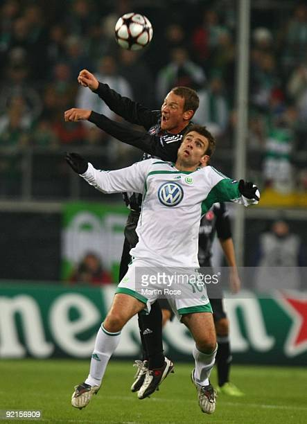 Edin Dzeko of Wolfsburg and Michael Fink of Besiktas jump for header during the UEFA Champions League Group B match between VfL Wolfsburg and...