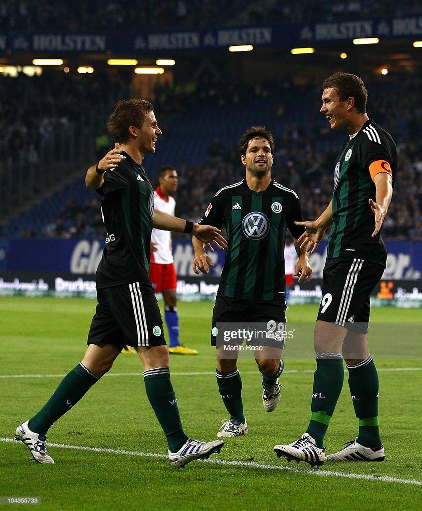 Edin Dzeko (R) of Wolfsburg celebrates after he scores his team's opening goal during the Bundesliga match between Hamburger SV and VFL Wolfsburg at Imtech Arena on September 22, 2010 in Hamburg, Germany.