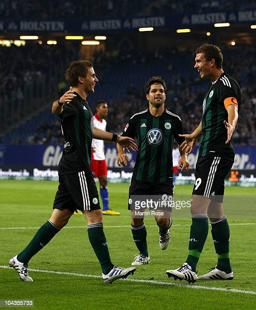 Edin Dzeko of Wolfsburg celebrates after he scores his team's opening goal during the Bundesliga match between Hamburger SV and VFL Wolfsburg at...