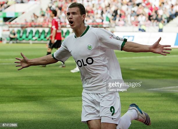 Edin Dzeko of Wolfsburg celebrates his second goal during the Bundesliga match between Hannover 96 and VfL Wolfsburg at the AWD Arena on May 16 2009...