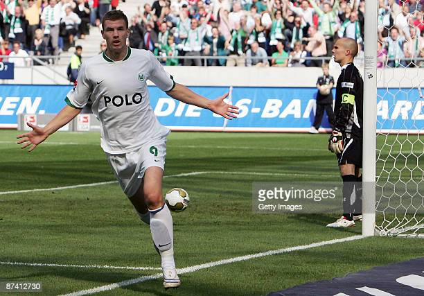 Edin Dzeko of Wolfsburg celebrates his second goal for lead 04 during the Bundesliga match between Hannover 96 and VfL Wolfsburg at the AWD Arena on...