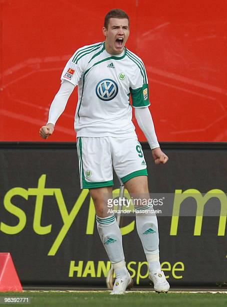 Edin Dzeko of Wolfsburg celebrates scoring the opening goal during the Bundesliga match between 1 FC Nuernberg and VfL Wolfsburg at Easycredit...