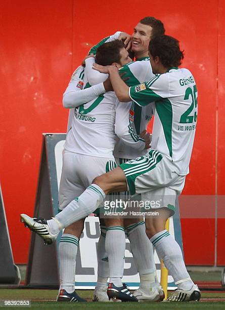 Edin Dzeko of Wolfsburg celebrates the second goal with his team mates during the Bundesliga match between 1 FC Nuernberg and VfL Wolfsburg at...