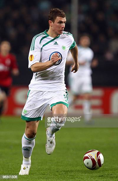 Edin Dzeko of Wolfsburg runs with the ball during the UEFA Europa League quarter final second leg match between VfL Wolfsburg and Fulham at...