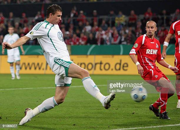 Edin Dzeko of Wolfsburg scores the third goal during the DFB Cup second round match between 1 FC Koeln and VfL Wolfsburg at RheinEnergieStadion on...