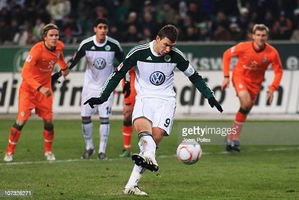 Edin Dzeko of Wolfsburg wastes a penalty during the Bundesliga match between VfL Wolfsburg and SV Werder Bremen at Volkswagen Arena on December 4...