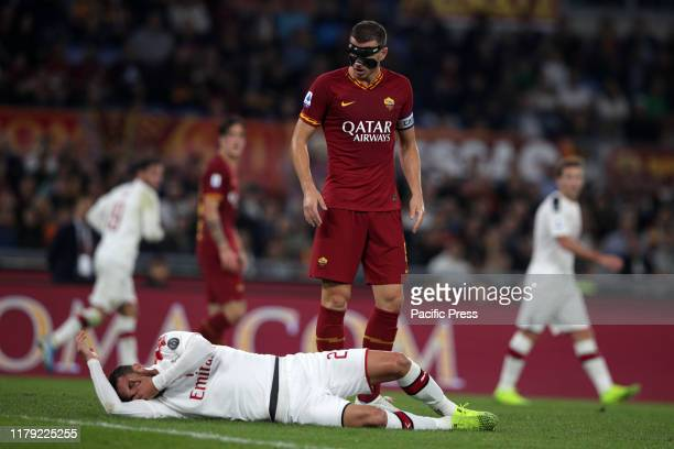 Edin Dzeko stand over Lucas Biglia during the Serie A match between AS Roma and AC Milan at Stadio Olimpico in Rome, Italy. A AS Roma beat AC Milan...