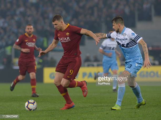 Edin Dzeko vies Francesco Acerbi during the Italian Serie A football match between SS Lazio and AS Roma at the Olympic Stadium in Rome on march 02...