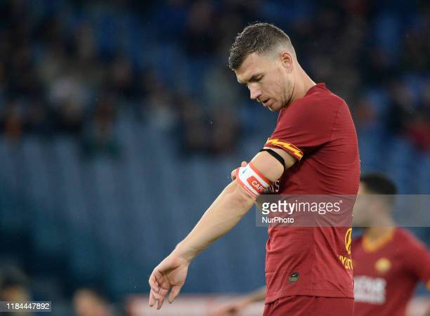 Edin Dzeko wears the captain's armband during the Italian Serie A football match between AS Roma and Brescia at the Olympic Stadium in Rome on...