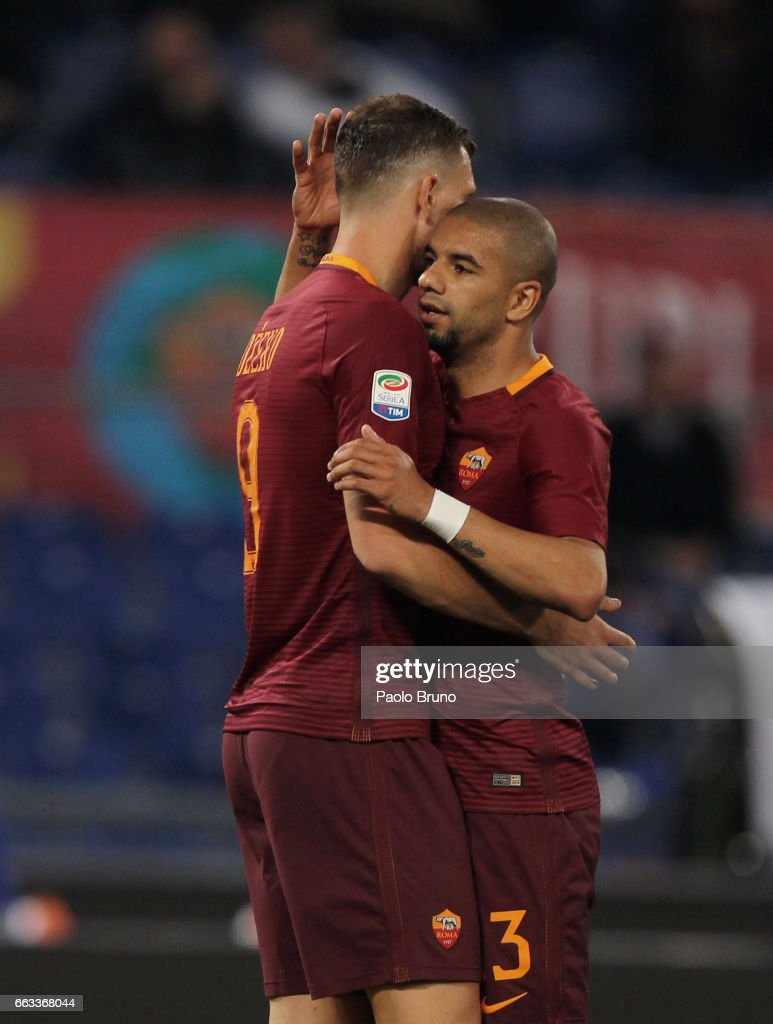 Edin Dzeko (L) with his teammate Bruno Peres of AS Roma celebrates after scoring the team's second goal during the Serie A match between AS Roma and Empoli FC at Stadio Olimpico on April 1, 2017 in Rome, Italy.