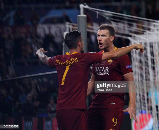 Edin Dzeko with his teammate L orenzo Pellegriniof AS Roma celebrates after scoring the opening goal during the Group G match of the UEFA Champions...