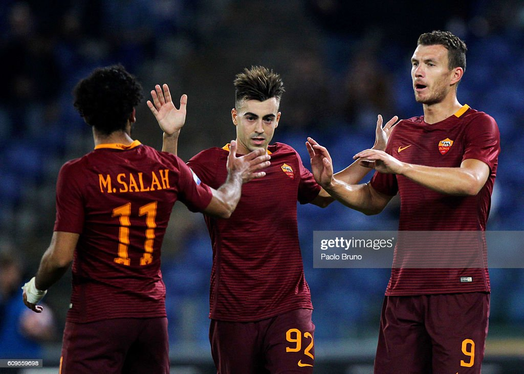 Edin Dzeko #9 with his teammates Mohamed Salah and Stefan El Shaarawy of AS Roma celebrates after scoring the team's fourth goal during the Serie A match between AS Roma and FC Crotone at Stadio Olimpico on September 21, 2016 in Rome, Italy.