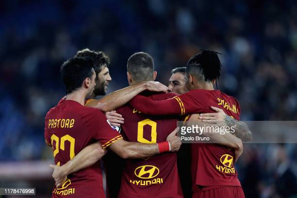 Edin Dzeko with his teammates of AS Roma celebrates after scoring the opening goal during the Serie A match between AS Roma and AC Milan at Stadio...