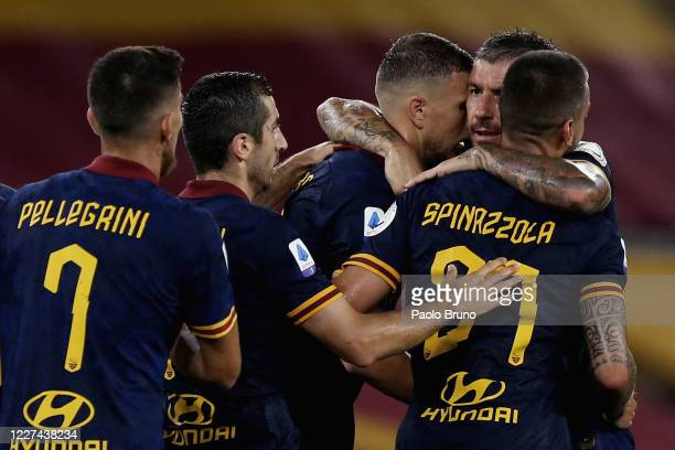 Edin Dzeko with his teammates of AS Roma celebrates after scoring the team's second goal during the Serie A match between AS Roma and Hellas Verona...