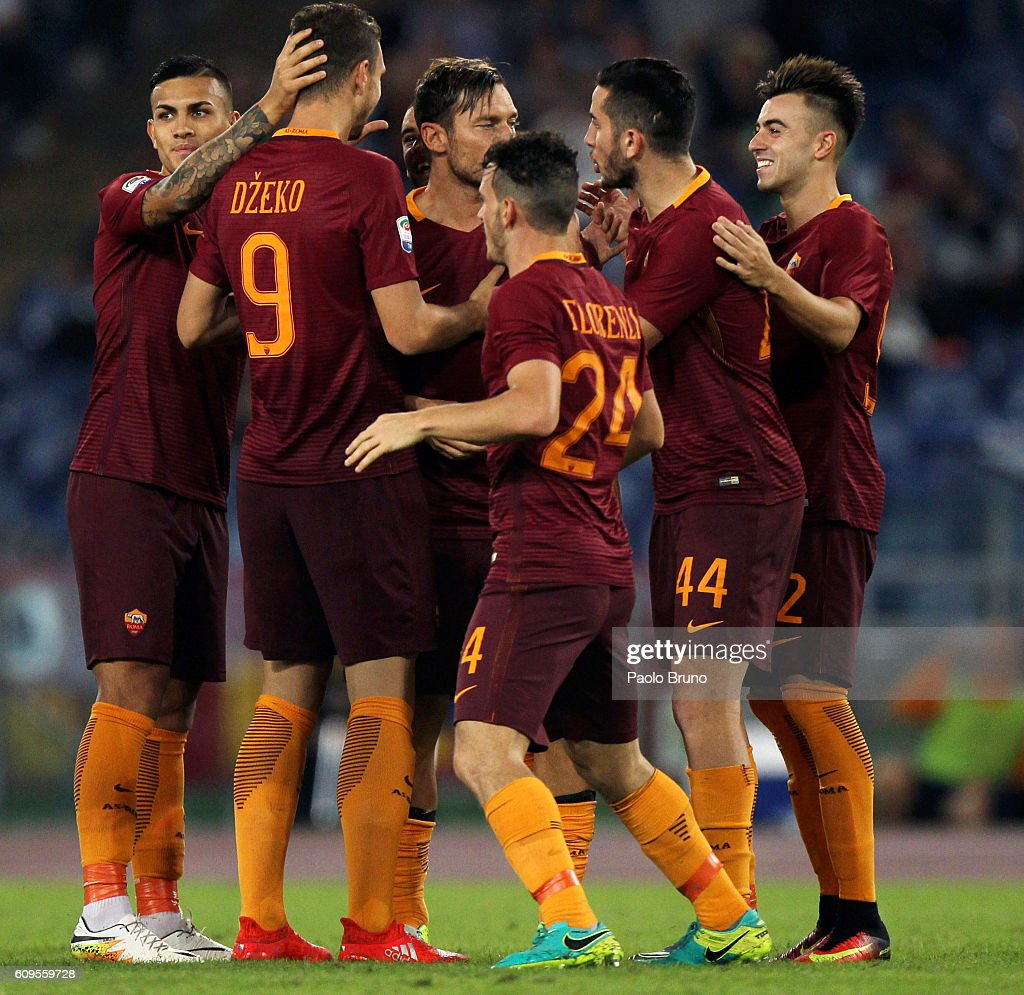 Edin Dzeko #9 with his teammates of AS Roma celebrates after scoring the team's third goal during the Serie A match between AS Roma and FC Crotone at Stadio Olimpico on September 21, 2016 in Rome, Italy.