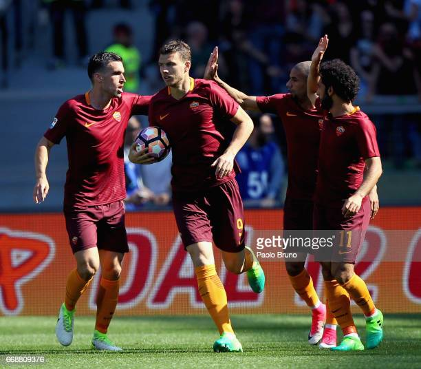 Edin Dzeko with his teammates of AS Roma celebrates after scoring the team's first goal during the Serie A match between AS Roma and Atalanta BC at...