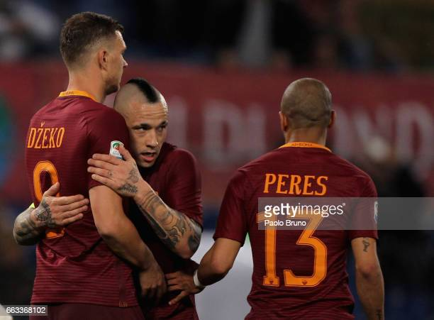Edin Dzeko with his teammates Radja Nainggolan and Bruno Peres of AS Roma celebrates after scoring the team's second goal during the Serie A match...