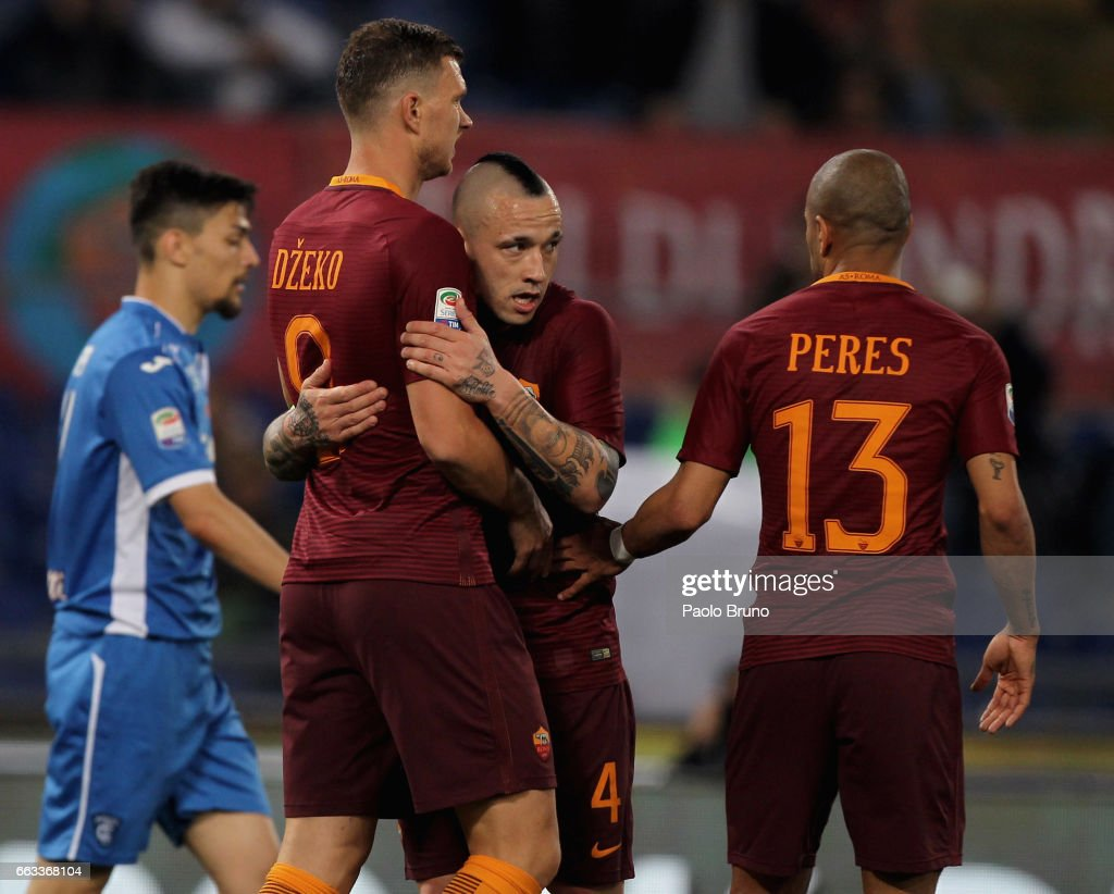 Edin Dzeko (L) with his teammates Radja Nainggolan and Bruno Peres of AS Roma celebrates after scoring the team's second goal during the Serie A match between AS Roma and Empoli FC at Stadio Olimpico on April 1, 2017 in Rome, Italy.