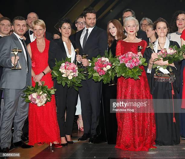Edin Hasanowic, Cordula Stratmann, Dunja Hayali, Gerald Butler, Julianne Moore, Helen Mirren and Maria Simon attend the Goldene Kamera 2016 show on...