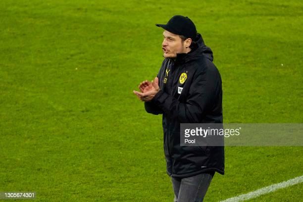 Edin Terzic, Head Coach of Borussia Dortmund reacts during the Bundesliga match between FC Bayern Muenchen and Borussia Dortmund at Allianz Arena on...