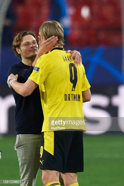 Edin Terzic head coach of Dortmund and Erling Haaland celebrate victory after the UEFA Champions League Round of 16 match between Sevilla FC and...